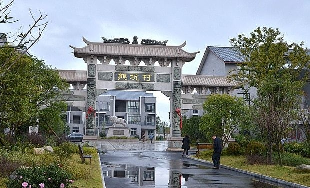 Chinese millionaire builds free luxury homes for entire village where he grew up