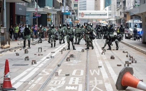 Hong Kong protesters barricade themselves in on university campuses