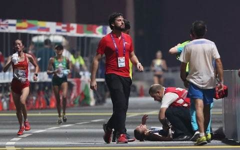 Havoc at 'disaster' Doha World Championships as numerous marathon athletes collapse in sweltering heat