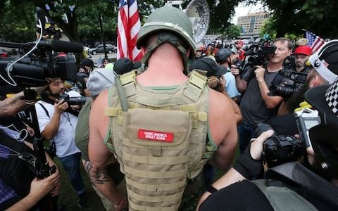 Portland police arrest 13 as far-right and antifa protesters face off