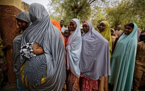 Explosions and gunfire mark opening of polls in Nigeria