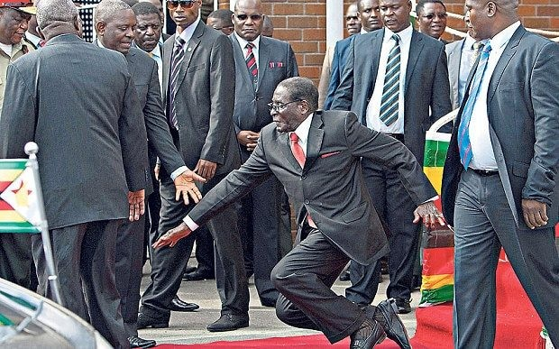 Zimbabwe's Robert Mugabe back to his 'sprightly self' after red carpet fall, regime insists