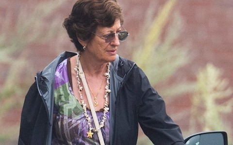 Ghislaine Maxwell's sister spotted packing up bags near home where socialite was rumoured to be staying