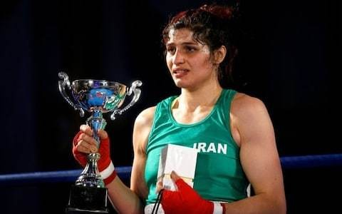 Iran's first champion female boxer cancels return home after arrest warrant issued