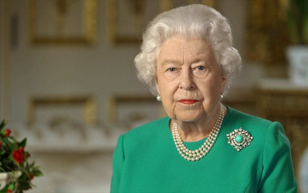 The real reason The Queen wore orange lipstick to address the nation