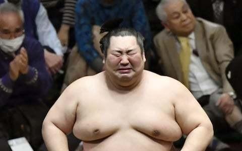 Tears of Japanese sumo outsider melt conservative wrestling world after shock tournament win