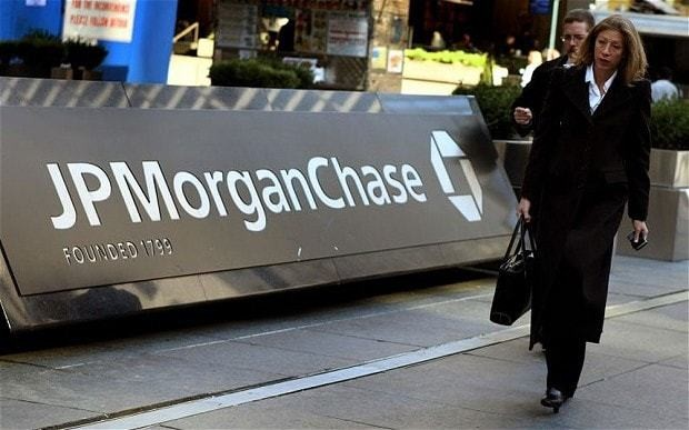 JP Morgan chief announces shake-up and warns of further 'legal issues'