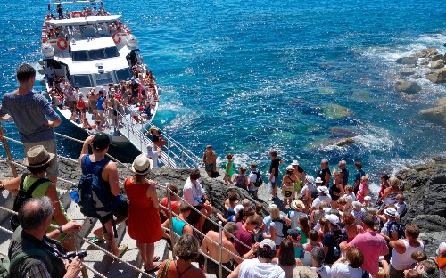 Tourists face fines for tackling tough trails of Italy's Cinque Terre in flip-flops
