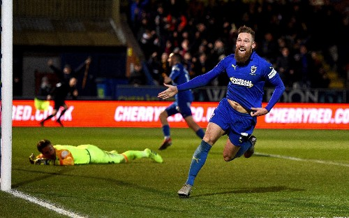AFC Wimbledon midfielder Scott Wagstaff says 'it better not rain' after dyeing his beard for FA Cup tie