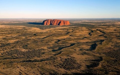 Tensions mount as 'entitled' tourists flood to Uluru to beat climbing ban