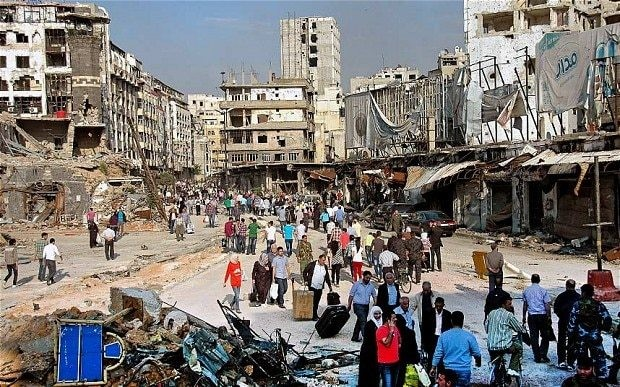 Hundreds of Syrians return to Homs to find a city of death