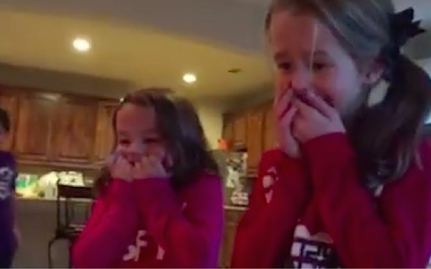 A couple surprised their daughters with an adopted baby brother under the Christmas tree - and their reaction is adorable