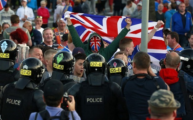 Hundreds of police from across UK to be deployed to Belfast after loyalist violence flares for third night