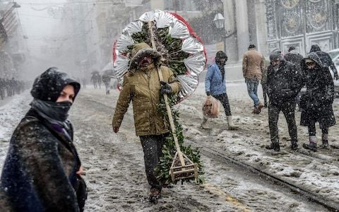 Snowstorms hold mainland Europe in an icy grip as scores succumb to bitterly cold weather
