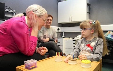 Pioneering brain surgery that allows deaf children to hear to be funded across the NHS