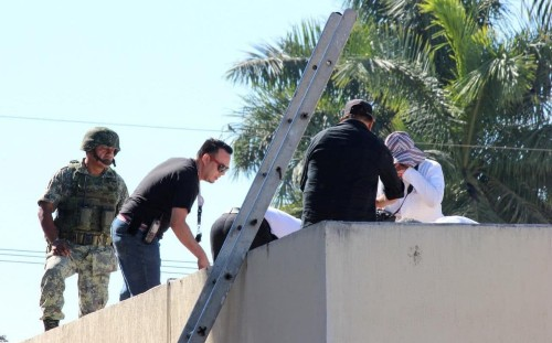 Man's body seen thrown from plane and found on roof of Mexican hospital