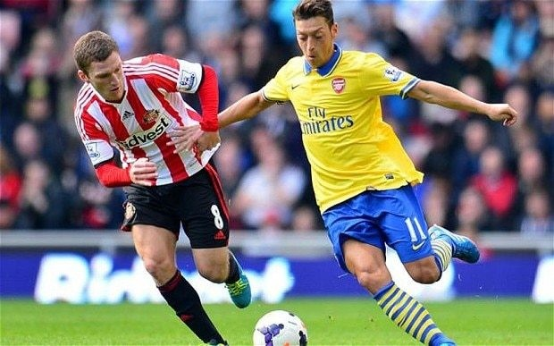 Mesut Özil class in debut triumph cannot hide all Arsenal's familiar flaws at the back