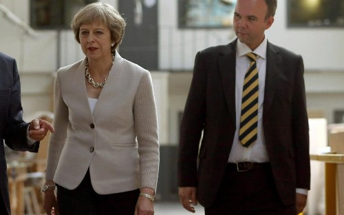 Theresa May says sorry to her MPs for the 'mess' caused by election campaign and vows to 'get us out of it'