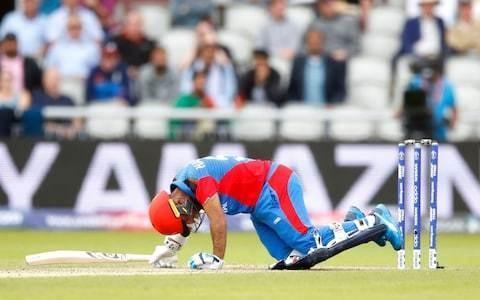 Afghanistan top scorer went against doctor's orders to bat on after Mark Wood broke his helmet