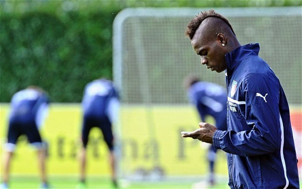 Mario Balotelli and Italy squad banned from Twitter at World Cup after striker called an 'imbecile'