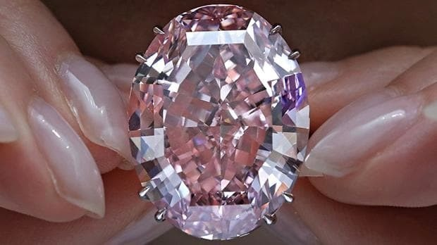 Sold: the Pink Star diamond sells for $71.2 million, becoming the world's most expensive gemstone - and is renamed the CTF Pink