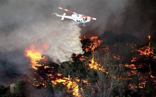 Australians flee deadly wildfire so fierce 'it is creating own weather'