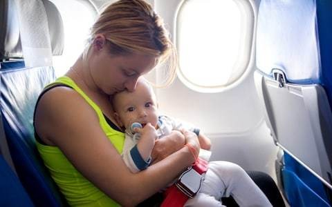 Forget books (and sleep) and prepare to be tutted at: 7 things you only know when you fly with a baby
