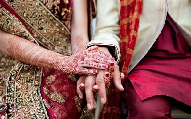Banker's claim that wife married imposter rejected by judge
