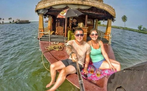 Young couple ditch dream jobs to live out of a rucksack and travel the world