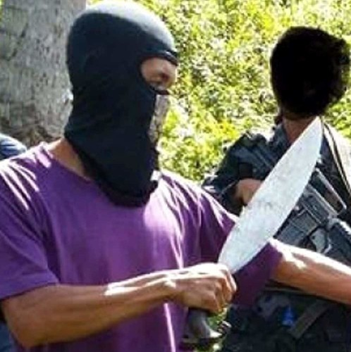 Canadian hostage 'beheaded' by armed Islamists in Philippines as Isil methods go global