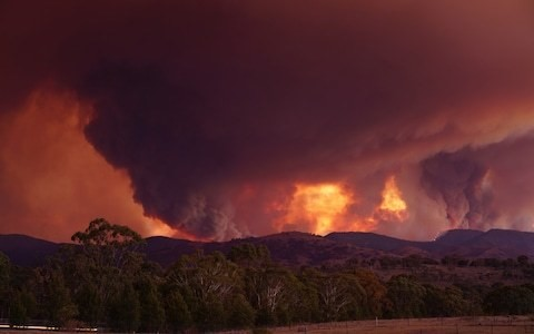 Army helicopter landing light starts bushfire threatening Australian capital