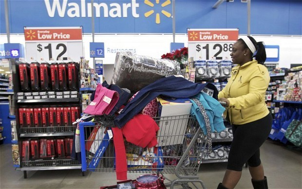 Wal-Mart profit warning sends shares tumbling