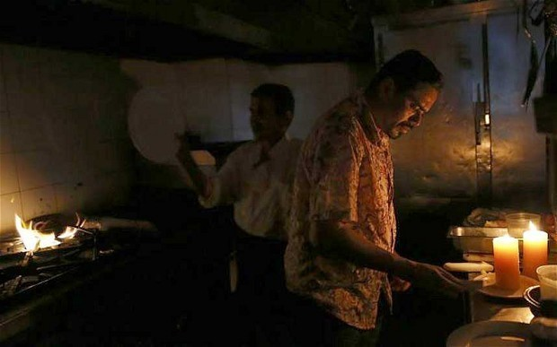 Venezuela blackout brings panic to roads and cuts short presidential address