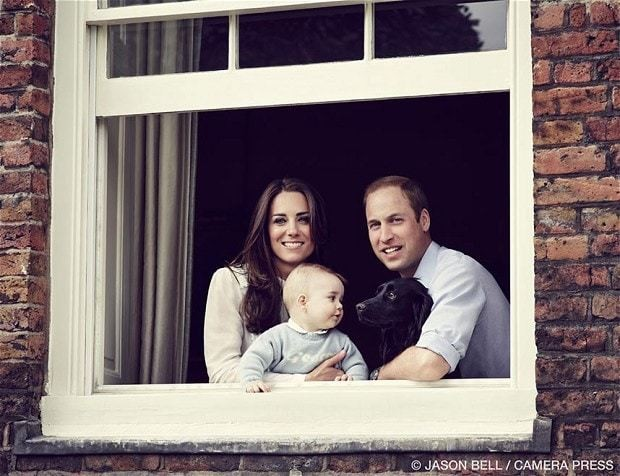 Prince George poses with parents - and their dog Lupo - for official portrait