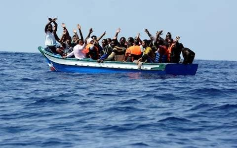 At least 65 migrants drown as boat capsizes off coast of Tunisia