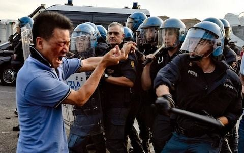 Police raid Italy's largest Chinatown to investigate attacks against Arab immigrants