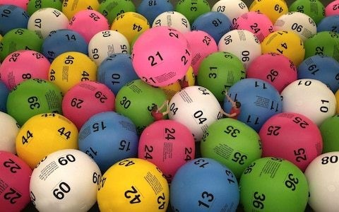 Ban under-18s from playing National Lottery games, MPs demand