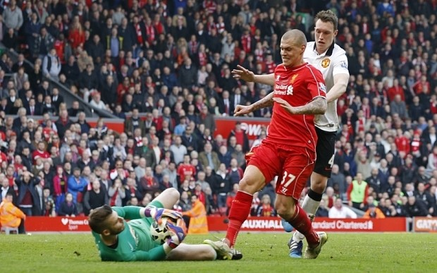 Liverpool's Martin Skrtel risks extra ban by contesting FA charge for 'stamp' on Manchester United's David De Gea