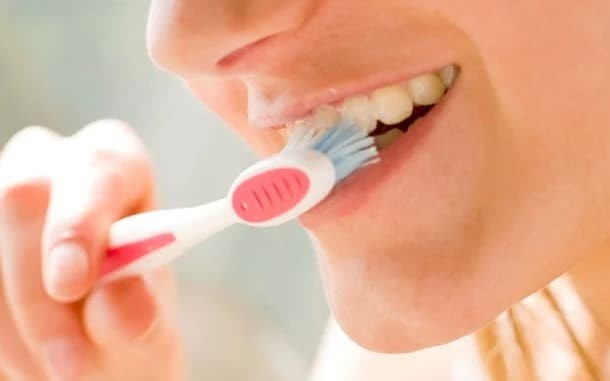 How brushing your teeth could help prevent a heart attack
