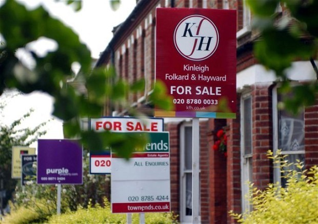 Mortgage approvals slow to seven-month low, as house price growth levels off