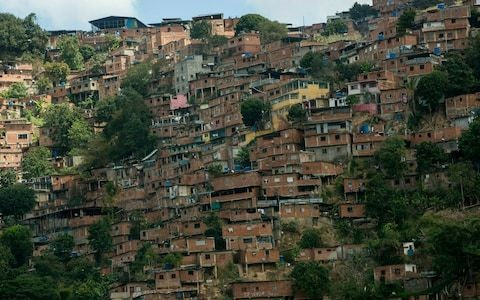 Venezuela's suffering barrios pray for change amid fears Juan Guaido's time is running out