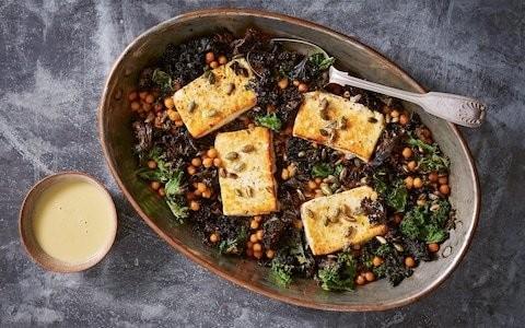 Baked feta with greens and lemon-tahini dressing recipe