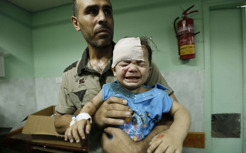Gaza conflict: Israel announces ceasefire after shelling UN school, in pictures - Telegraph
