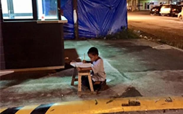 Homeless boy using McDonald's light to do homework proves inspirational