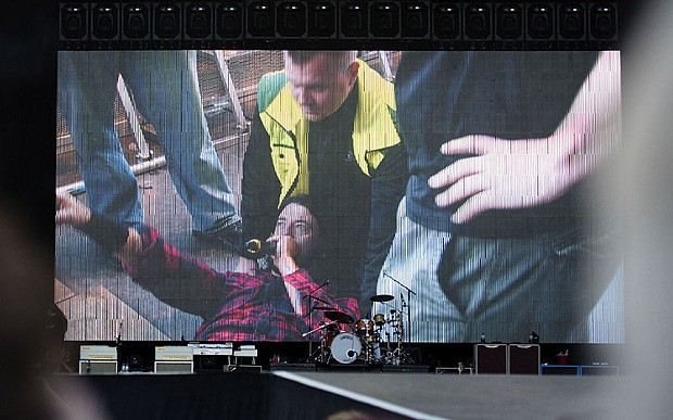 Foo Fighters frontman Dave Grohl falls off stage, breaks leg, then finishes gig