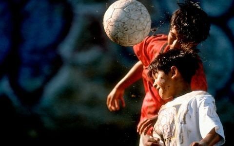 Exclusive: Calls for ban on young players heading footballs as brain-injury expert says under 18s are in danger