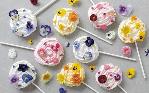 Meringue lollies with edible flowers recipe