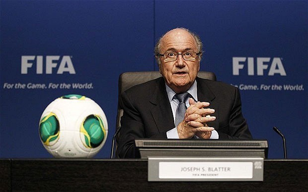 Fifa president Sepp Blatter backtracks on calls to dock clubs points for racist abuse