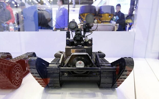 China unveils 'armed attack' robots armed with guns and grenades