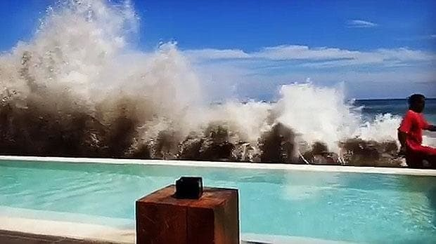 Bali tourists film giant waves crashing onto hotel poolside amid fears of 'tsunami'